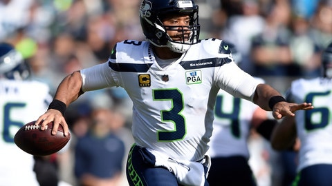 <p>               FILE - In this Nov. 25, 2018, file photo, Seattle Seahawks' Russell Wilson (3) looks to pass against the Carolina Panthers during the first half of an NFL football game in Charlotte, N.C. Through 12 games Wilson has 29 touchdowns and just five interceptions. He has thrown at least two TD passes in eight straight games and 11 of 12 this season. (AP Photo/Mike McCarn, File)             </p>