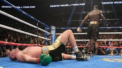 <p>               Tyson Fury, of England, lies on the canvas after being knocked down by Deontay Wilder during the 12th round of a WBC heavyweight championship boxing match Saturday, Dec. 1, 2018, in Los Angeles. (AP Photo/Mark J. Terrill)             </p>