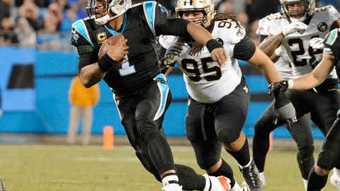 <p>               Carolina Panthers' Cam Newton (1) scrambles past New Orleans Saints' Tyeler Davison (95) in the first half of an NFL football game in Charlotte, N.C., Monday, Dec. 17, 2018. (AP Photo/Mike McCarn)             </p>