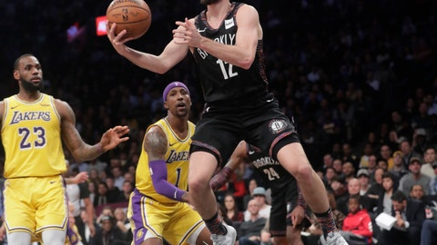 <p>               Brooklyn Nets' Joe Harris (12) drives past Los Angeles Lakers' LeBron James (23) during the second half of an NBA basketball game Tuesday, Dec. 18, 2018, in New York. The Nets won 115-110. (AP Photo/Frank Franklin II)             </p>