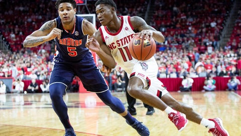 <p>               North Carolina State's Markell Johnson (11) drives against Auburn's Chuma Okeke (5) during the first half of an NCAA college basketball game in Raleigh, N.C., Wednesday, Dec. 19, 2018. (AP Photo/Ben McKeown)             </p>