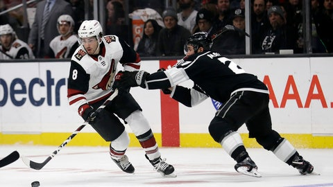 <p>               Arizona Coyotes' Nick Schmaltz (8) is defended by Los Angeles Kings' Alec Martinez during the first period of an NHL hockey game Tuesday, Dec. 4, 2018, in Los Angeles. (AP Photo/Marcio Jose Sanchez)             </p>