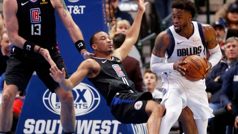 <p>               Los Angeles Clippers guard Avery Bradley (11) falls as he is fouled by Dallas Mavericks guard Wesley Matthews (23) as Clippers center Marcin Gortat (13) defends during the first half of an NBA basketball game in Dallas, Sunday, Dec. 2, 2018. (AP Photo/Michael Ainsworth)             </p>