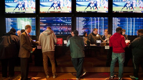 "<p>               FILE - In this Thursday, Dec. 13, 2018, file photo, gamblers place bets in the temporary sports betting area at the SugarHouse Casino in Philadelphia. The federal government would regulate sports betting nationwide under a bill to be introduced Wednesday, Jan. 19,2018. The bill would have the U.S. Justice Department set minimum standards states must meet in order to offer sports betting, but denies the sports leagues the so-called ""integrity fees"" they have been seeking in new legislation, essentially a cut of sport betting revenue. (AP Photo/Matt Rourke, File)             </p>"