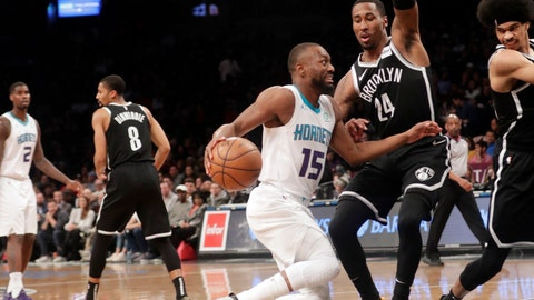 <p>               Charlotte Hornets' Kemba Walker (15) drives past Brooklyn Nets' Rondae Hollis-Jefferson (24) during the first half of an NBA basketball game Wednesday, Dec. 26, 2018, in New York. (AP Photo/Frank Franklin II)             </p>