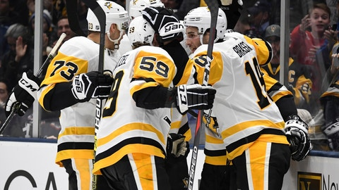 <p>               Pittsburgh Penguins players celebrate a goal by center Derick Brassard (19) during the third period of an NHL hockey game against the New York Islanders, Monday, Dec. 10, 2018, in Uniondale, N.Y. (AP Photo/Kathleen Malone-Van Dyke)             </p>