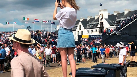 <p>               In this July 22, 2018 photo, a young girl stands atop a trash bin to catch a glimpse of Tiger Woods as he tees off in the final round of the British Open Golf Championship in Carnoustie, Scotland. Woods was must-see golf during his comeback this year. (AP Photo/Doug Ferguson)             </p>