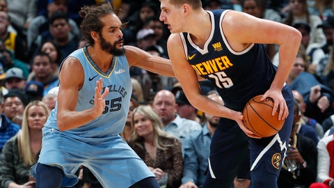 <p>               Denver Nuggets center Nikola Jokic, right, looks to pass the ball as Memphis Grizzlies center Joakim Noah defends in the first half of an NBA basketball game Monday, Dec. 10, 2018, in Denver. (AP Photo/David Zalubowski)             </p>