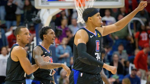 <p>               Los Angeles Clippers guard Lou Williams (23) is congratulated by guard Avery Bradley (11) as forward Tobias Harris (34) celebrates the two point basket late in the game to give the Clippers a lead against the New Orleans Pelicans in the second half of an NBA basketball game in New Orleans, La. Monday, Dec. 3, 2018. (AP Photo/Matthew Hinton)             </p>