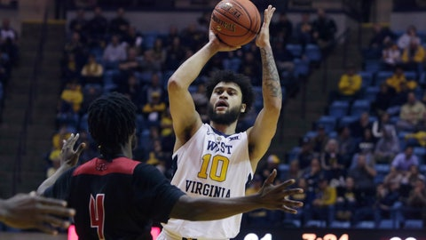 <p>               West Virginia guard Jermaine Haley (10) looks to make a pass while defended by Jacksonville State center Ty Hudson (4) during the second half of an NCAA college basketball game Saturday, Dec. 22, 2018, in Morgantown, W.Va. (AP Photo/Raymond Thompson)             </p>