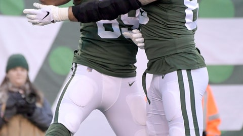 <p>               New York Jets tight end Chris Herndon, left, celebrates his touchdown catch with tight end Eric Tomlinson (83) during the second half of an NFL football game against the Green Bay Packers, Sunday, Dec. 23, 2018, in East Rutherford, N.J. (AP Photo/Bill Kostroun)             </p>