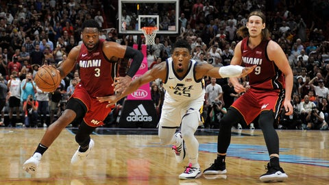 <p>               Utah Jazz guard Donovan Mitchell(45) reacts as Miami Heat's Dwyane Wade (3) drives past during the second half of an NBA basketball game, Sunday, Dec 2, 2018, in Miami. (AP Photo/Gaston De Cardenas)             </p>