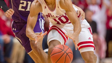<p>               Indiana guard Rob Phinisee (10) makes a pass to a teammate after getting around the defense of Northwestern forward A.J. Turner (21) during the second half of an NCAA college basketball game Saturday, Dec. 1, 2018, in Bloomington, Ind. Indiana won 68-66. (AP Photo/Doug McSchooler)             </p>