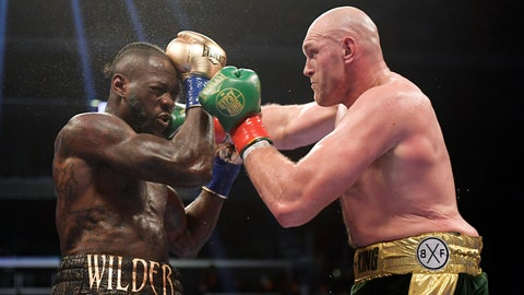 <p>               FILE - In this Dec. 1, 2018, file photo, Tyson Fury, right, of England, connects with Deontay Wilder during a WBC heavyweight championship boxing match in Los Angeles. Wilder is still frustrated by the way he fought in his draw with Fury. The WBC heavyweight champion watched a replay of the fight for the first time Thursday, Dec. 6, 2018, and saw things he did incorrectly. (AP Photo/Mark J. Terrill, File)             </p>