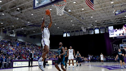 <p>               Furman's Tre Clark drives in for a basket while defended by North Carolina Wilmington's Ty Taylor during the first half of an NCAA college basketball game Saturday, Dec. 15, 2018, in Greenville, S.C. (AP Photo/Richard Shiro)             </p>