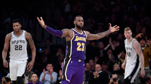 <p>               Los Angeles Lakers forward LeBron James, center, gestures after scoring as San Antonio Spurs forward Rudy Gay, left, and forward Davis Bertans, of Latvia, look on during the second half of an NBA basketball game, Wednesday, Dec. 5, 2018, in Los Angeles. The Lakers won 121-113. (AP Photo/Mark J. Terrill)             </p>
