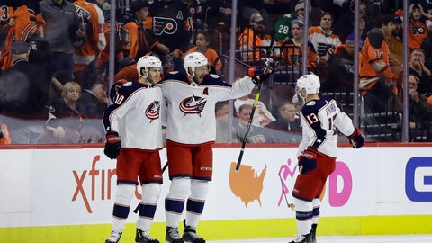 <p>               Columbus Blue Jackets' Seth Jones, center, celebrates with Cam Atkinson, right, and Alexander Wennberg after scoring in overtime of the team's NHL hockey game against the Philadelphia Flyers, Thursday, Dec. 6, 2018, in Philadelphia. Columbus won 4-3. (AP Photo/Matt Slocum)             </p>