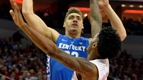 <p>               Kentucky forward Reid Travis (22) shoots over the defense of Louisville center Malik Williams (5) during the first half of an NCAA college basketball game in Louisville, Ky., Saturday, Dec. 29, 2018. (AP Photo/Timothy D. Easley)             </p>