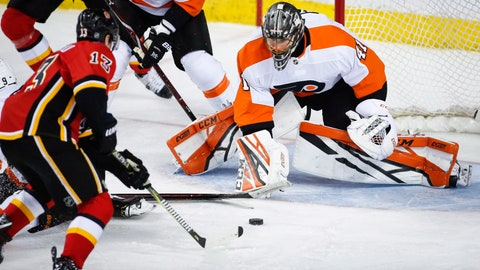 <p>               Philadelphia Flyers goalie Anthony Stolarz, right, blocks the net on Calgary Flames' Johnny Gaudreau during the second period of an NHL hockey game, Wednesday, Dec. 12, 2018, in Calgary, Alberta. (Jeff McIntosh/The Canadian Press via AP)             </p>
