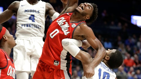 <p>               Mississippi guard Blake Hinson (0) reaches for the ball between Middle Tennessee forward James Hawthorne (4) and guard Jayce Johnson (10) during the first half of an NCAA college basketball game Friday, Dec. 21, 2018, in Nashville, Tenn. Mississippi won 74-56. (AP Photo/Mark Humphrey)             </p>