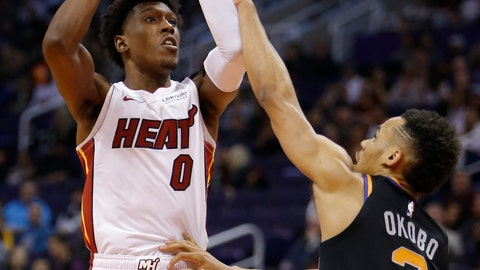 <p>               Miami Heat guard Josh Richardson (0) shoots over Phoenix Suns guard Elie Okobo during the first half of an NBA basketball game Friday, Dec. 7, 2018, in Phoenix. (AP Photo/Rick Scuteri)             </p>