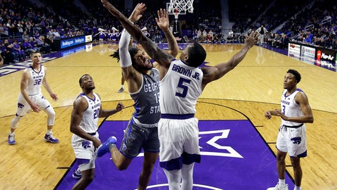 <p>               Georgia State's D'Marcus Simonds (15) shoots under pressure from Kansas State's Barry Brown Jr. (5) during the first half of an NCAA college basketball game Saturday, Dec. 15, 2018, in Manhattan, Kan. (AP Photo/Charlie Riedel)             </p>
