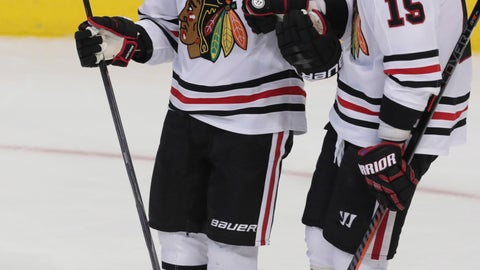 <p>               Chicago Blackhawks right wing Patrick Kane (88) celebrates his goal with center Artem Anisimov (15) during the third period of an NHL hockey game against the Dallas Stars in Dallas, Thursday, Dec. 20, 2018. The Blackhawks won 5-2. (AP Photo/LM Otero)             </p>