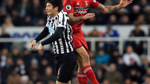 <p>               Newcastle United's Ki Sung-yueng, left, and Fulham's Aleksandar Mitrovic jump for the ball during the English Premier League soccer match between Newcastle United and Fulham at St James' Park, Newcastle, England. Saturday, Dec. 22, 2018. (Owen Humphreys/PA via AP)             </p>