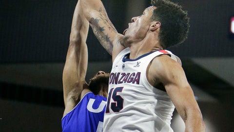 <p>               Gonzaga forward Brandon Clarke (15) blocks a shot by Texas-Arlington guard Edric Dennis during the first half of an NCAA college basketball game in Spokane, Wash., Tuesday, Dec. 18, 2018. (AP Photo/Young Kwak)             </p>
