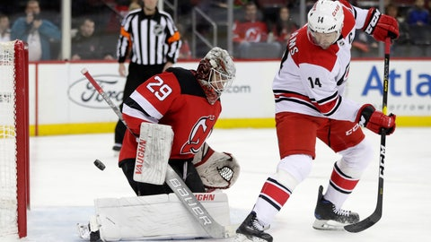 <p>               New Jersey Devils goaltender MacKenzie Blackwood (29) blocks a shot from Carolina Hurricanes right wing Justin Williams (14) during the first period of an NHL hockey game, Saturday, Dec. 29, 2018, in Newark, N.J. (AP Photo/Julio Cortez)             </p>