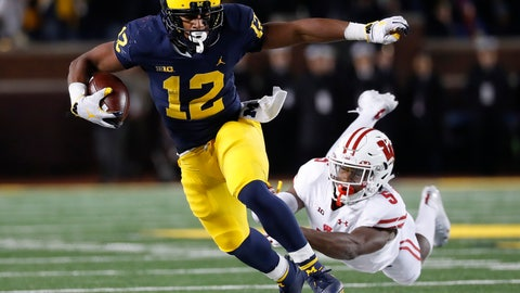 <p>               File-This Oct. 13, 2018, shows Michigan running back Chris Evans (12) shaking the tackle of Wisconsin cornerback Rachad Wildgoose (5) during the second half of an NCAA college football game in Ann Arbor, Mich. Evans, a junior, may lead Michigan's running back committee in the Peach Bowl, that also is expected to include Tru Wilson and Christian Turner.  (AP Photo/Paul Sancya, File)             </p>