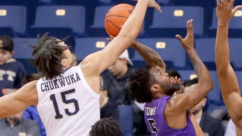 <p>               Kene Chukwuka (15) bocks a shot by Niagara's James Towns (5) during the first half of an NCAA college basketball game, Monday, Dec. 3, 2018, in Pittsburgh. (AP Photo/Keith Srakocic)             </p>