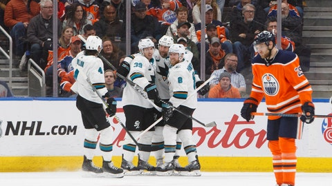 <p>               San Jose Sharks celebrate a goal as Edmonton Oilers' Leon Draisaitl (29) skate past during the second period of an NHL hockey game, Saturday, Dec. 29, 2018 in Edmonton, Alberta. (Jason Franson/The Canadian Press via AP)             </p>