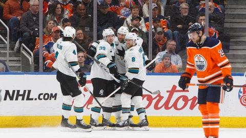 <p>               San Jose Sharks celebrate a goal as Edmonton Oilers' Leon Draisaitl (29) skate past during the second period of an NHL hockey game, Saturday, Dec. 29, 2018 in Edmonton, Alberta. (Jason Franson/The Canadian Press via AP)             </p>
