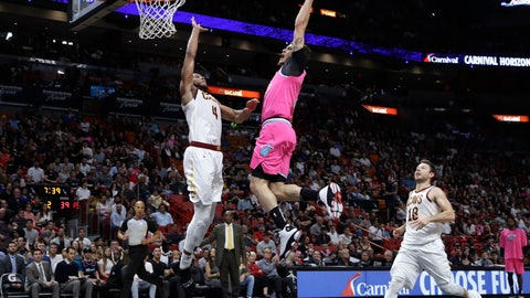 <p>               Miami Heat guard Tyler Johnson, center, drives to the basket over Cleveland Cavaliers forward Jaron Blossomgame (4) and guard Matthew Dellavedova (18) during the first half of an NBA basketball game, Friday, Dec. 28, 2018, in Miami. (AP Photo/Lynne Sladky)             </p>