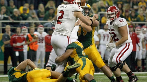 <p>               FILE - In this Oct. 17, 2015 file photo, the football pops out of South Dakota quarterback Ryan Saeger's hands on a first quarter sack by North Dakota State defenders, below, during an NCAA college football game in Fargo, N.D. South Dakota State has advanced to the Football Championship Subdivision semifinals for the second straight year and its reward is a matchup against powerful rivals North Dakota State.  (AP Photo/Bruce Crummy, File)             </p>