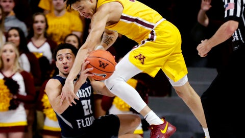 <p>               North Florida guard Brian Coffey II (20) looks to pass as Minnesota guard Amir Coffey (5) reaches in during the first half of an NCAA college basketball game Tuesday, Dec. 11, 2018, in Minneapolis. (AP Photo/Andy Clayton-King)             </p>