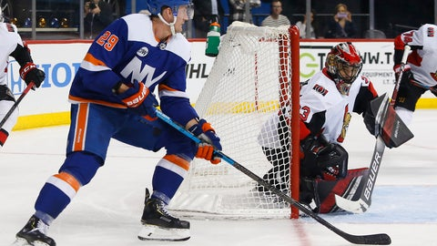 <p>               Ottawa Senators goaltender Mike McKenna (33) defends against New York Islanders center Brock Nelson (29) during the second period of an NHL hockey game, Friday, Dec. 28, 2018, in New York. (AP Photo/Noah K. Murray)             </p>