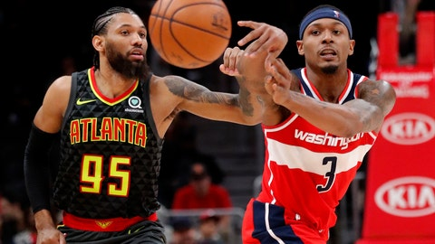 <p>               Washington Wizards guard Bradley Beal (3) passes as Atlanta Hawks forward DeAndre' Bembry (95) defends during the second half of an NBA basketball game Wednesday, Dec. 5, 2018, in Atlanta. Washington won 131-117. (AP Photo/John Bazemore)             </p>
