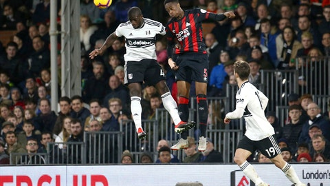 <p>               Fulham's Aboubakar Kamara, left, and Huddersfield Town's Terence Kongolo jump for a high ball during their English Premier League soccer match at Craven Cottage in London, Saturday Dec. 29, 2018. (Yui Mok/PA via AP)             </p>