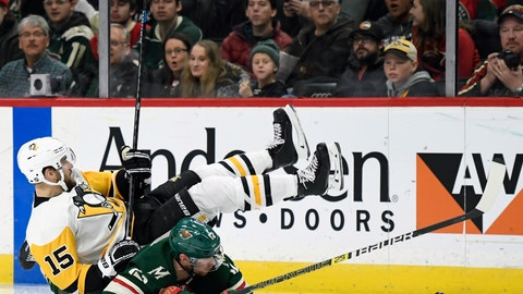 <p>               Minnesota Wild's Eric Staal (12) and Pittsburgh Penguins' Riley Sheahan (15) fall while going after the puck during the second period of an NHL hockey game Monday, Dec. 31, 2018, in St. Paul, Minn. (AP Photo/Hannah Foslien)             </p>