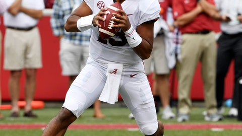 <p>               FILE - In this Oct. 6, 2018, file photo, Alabama quarterback Tua Tagovailoa rolls out before throwing a touchdown pass on the first play of the game against Arkansas in the first half of an NCAA college football game, in Fayetteville, Ark. Tagovailoa is the offensive player of the year and one of five members of the top-ranked Crimson Tide to earn first-team honors on The Associated Press All-Southeastern Conference team, announced Monday, Dec. 3, 2018. Tagovailoa, one of the prime contenders for the Heisman Trophy, has thrown 37 touchdown passes with only four interceptions to rank second nationally in passing efficiency. (AP Photo/Michael Woods, File)             </p>