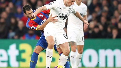 <p>               Crystal Palace's Luka Milivojevic, left, and Burnley's Chris Wood compete for the ball during the English Premier League soccer match between Crystal Palace and Burnley F.C at Selhurst Park Stadium, London. Saturday Dec. 1, 2018. (John Walton/PA via AP)             </p>
