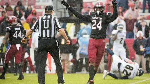 <p>               South Carolina defensive back Israel Mukuamu (24) celebrates a defensive stop against Akron during the first half of an NCAA college football game Saturday, Dec. 1, 2018, in Columbia, S.C. South Carolina defeated Akron 28-3. (AP Photo/Sean Rayford)             </p>