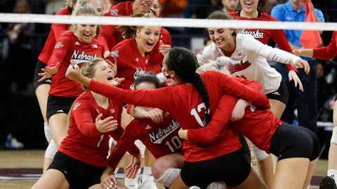 <p>               Nebraska players celebrate after defeating Illinois in the five sets in the semifinal match of the NCAA Div I Women's Volleyball Championships Thursday, Dec. 13, 2018, in Minneapolis. (AP Photo/Andy Clayton-King)             </p>