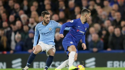 <p>               Chelsea's Eden Hazard, right, and Manchester City's Bernardo Silva fight for the ball during the English Premier League soccer match between Chelsea and Manchester City at Stamford Bridge in London, Saturday Dec. 8, 2018. (AP Photo/Tim Ireland)             </p>
