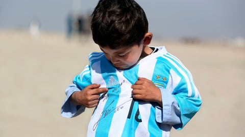 <p>               FILE - In this Friday, Feb. 26, 2016 file photo, five-year-old Afghan Lionel Messi fan Murtaza Ahmadi poses for photograph, as he wears a shirt signed by Messi, in Kabul, Afghanistan. A young Afghan soccer fan who shot to fame after he was photographed in a Messi shirt made from a plastic bag has been forced to flee with his family to the Afghan capital after criminal gangs and the Taliban threatened to kill or kidnap him. Shafiqa Ahmedi said Friday, Dec. 7, 2018 that criminals threatened to kidnap her now-7-year-old son Murtaza, a fan of Argentinian soccer star Lionel Messi, after demanding money. (AP Photo/Rahmat Gul, file)             </p>