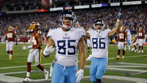 <p>               Tennessee Titans tight end MyCole Pruitt (85) flips the ball over his shoulder after he scored a touchdown on a 2-yard pass reception against the Washington Redskins in the second half of an NFL football game Saturday, Dec. 22, 2018, in Nashville, Tenn. (AP Photo/James Kenney)             </p>