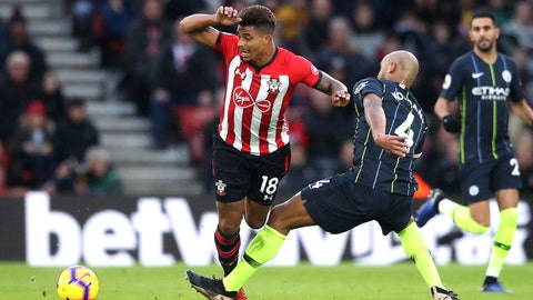 <p>               Manchester City's Vincent Kompany, right, tackles Southampton's Mario Lemina, during their English Premier League soccer match at St Mary's Stadium in Southampton, England, Sunday Dec. 30, 2018. (Adam Davy/PA via AP)             </p>
