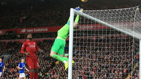 <p>               Everton goalkeeper Jordan Pickford, right, saves a ball in front of Liverpool forward Divock Origi before he scores his side's first goal during the English Premier League soccer match between Liverpool and Everton at Anfield Stadium in Liverpool, England, Sunday, Dec. 2, 2018. (AP Photo/Jon Super)             </p>
